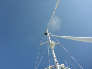 Jas, aloft, removing the padding off the spreaders that had protected the main sail.